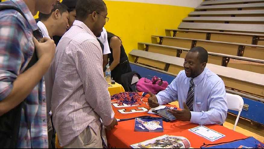 A representative of Lincoln University speaks with students at Grant High School.