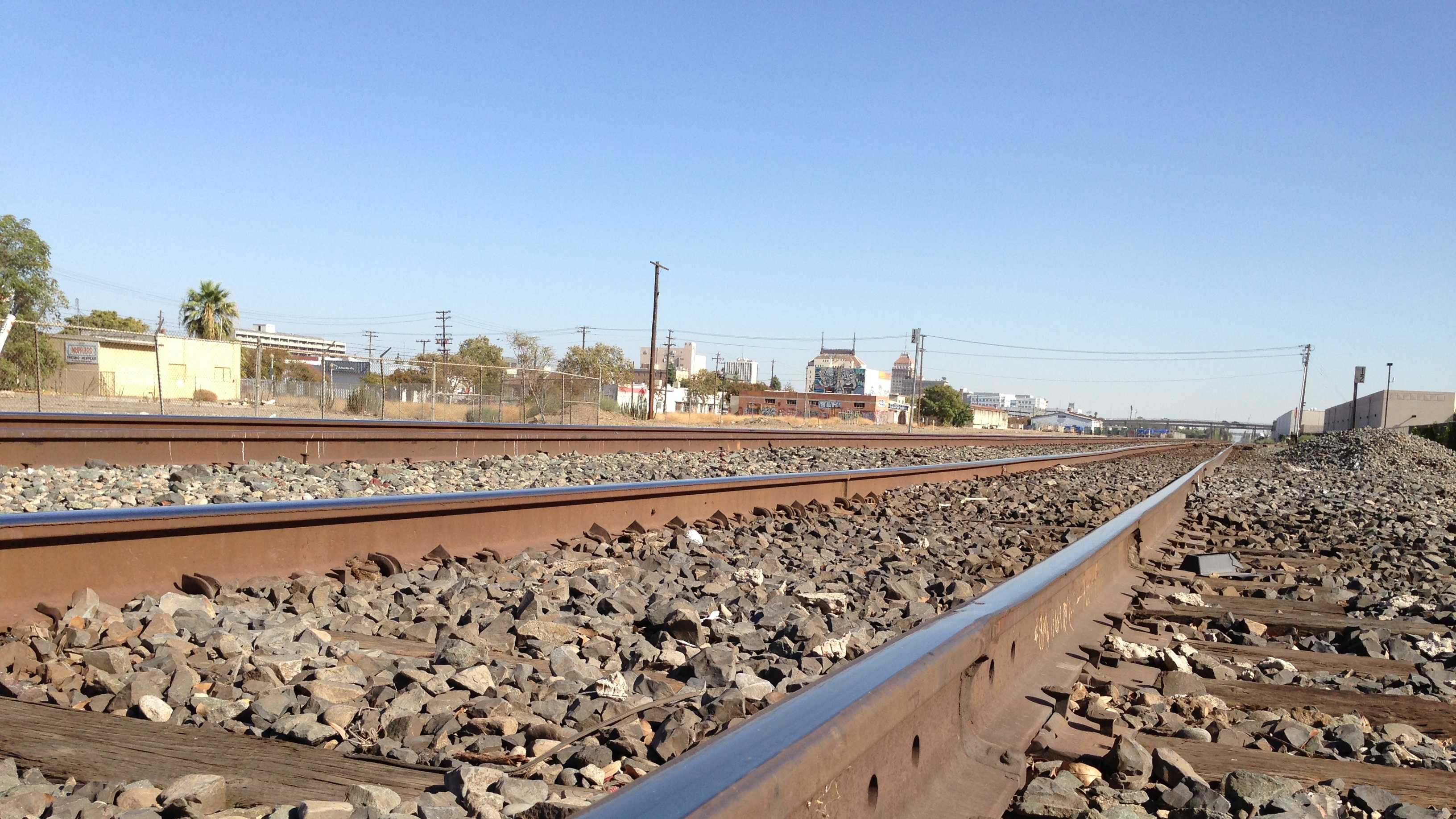 The high-speed rail line will parallel these freight train tracks in downtown Fresno.