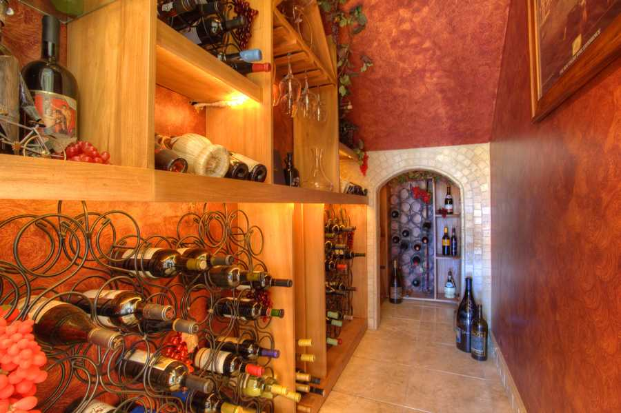 Open up the wine aficionado within by using this wine den for storing -- and tasting -- your best vintages.