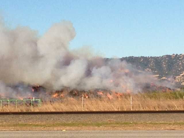 The fire is burning at Hay Kingdom, a hay exporting company.