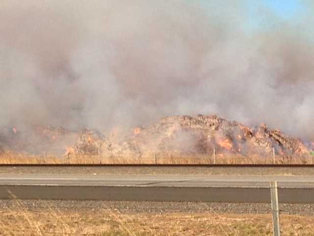 Fire officials tell KCRA 3 the blaze began on Thursday night and has consumed about 10 acres of stored hay.
