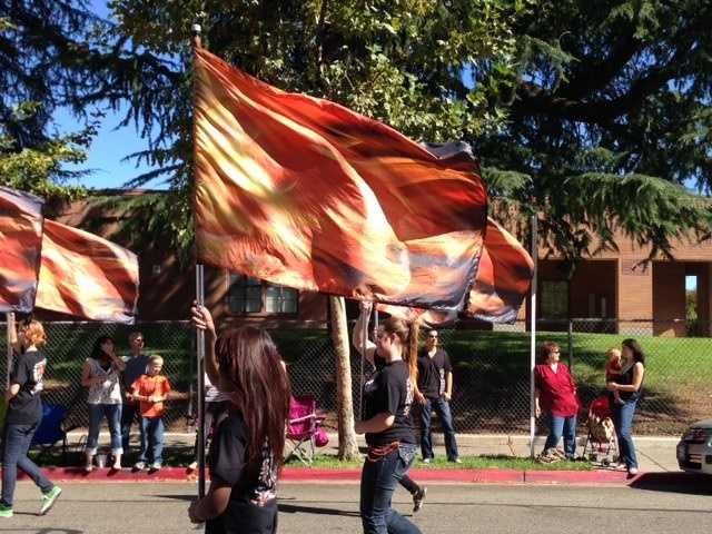 Roseville's color guard was in the parade showing the orange and black colors of RHS.