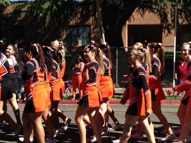 Cheerleaders walked along the streets as they showed some Tiger spirit.