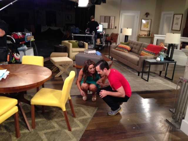 """Who's line is it?Lisa Gonzales crouches with Thomas Lennon of the NBC comedy, """"Sean Saves the World,"""" in animprovbit during an interview."""