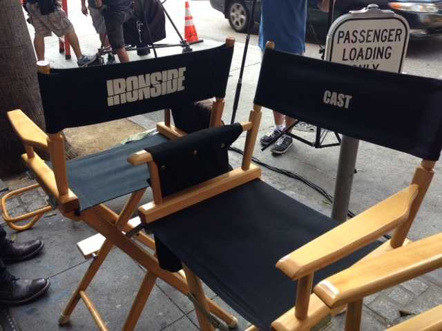 """Chairs for cast members of """"Ironside"""" are unoccupied."""