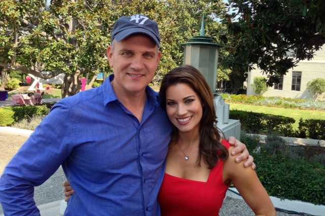 """Lisa Gonzales stands with Mike O'Malley of the NBC comedy, """"Welcome to the Family."""""""