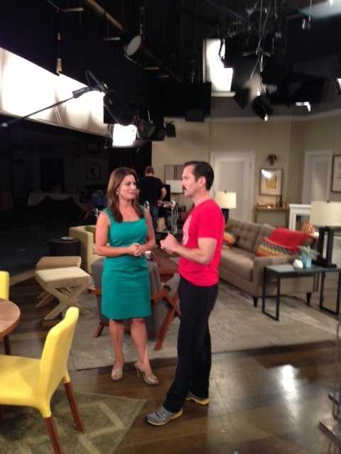"""Lisa Gonzales chats with Thomas Lennon of the NBC comedy, """"Sean Saves the World,"""" on set."""