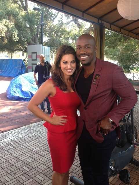 """Lisa Gonzales takes a photo with one of """"The Biggest Loser"""" trainers, Dolvett Quince."""