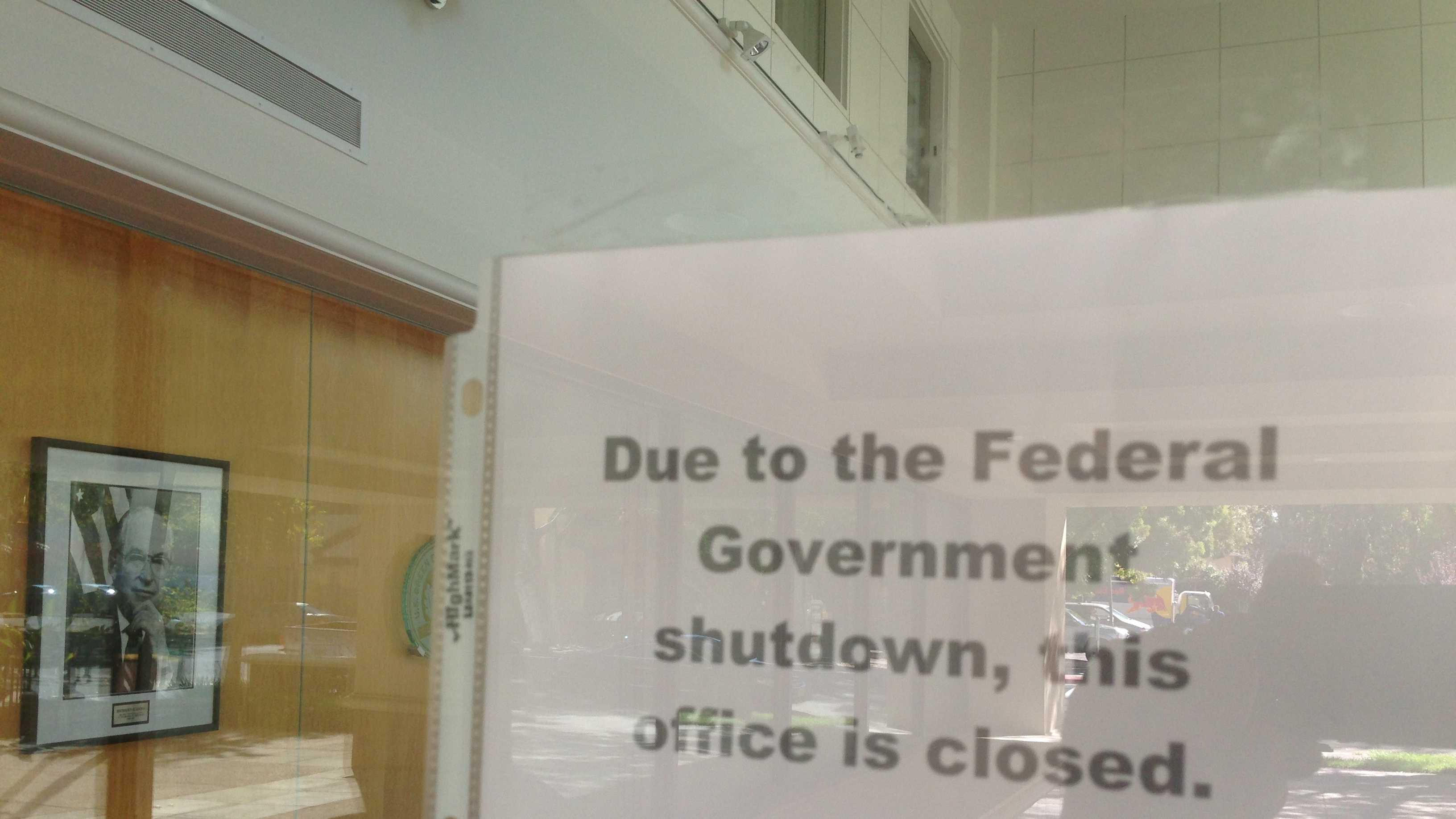 A sign on the U.S. Department of Agriculture building in Davis says the offices are closed.