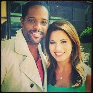 "Lisa Gonzales smiles alongside Blair Underwood, star of the new NBC drama ""Ironside."""