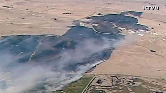 A large grass fire charred hundreds of acres in Solano County Friday afternoon.