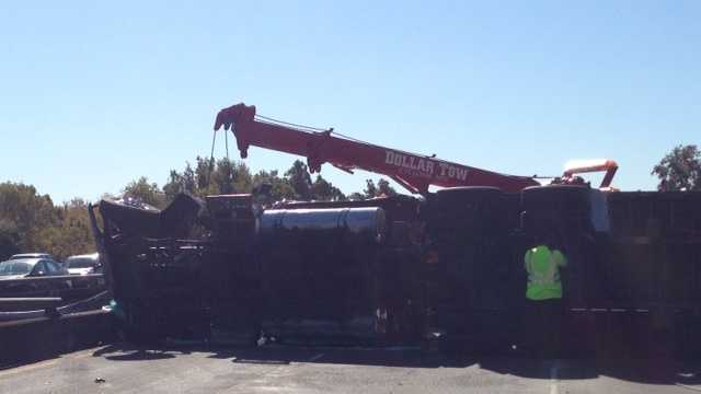 A crash involving three vehicles, including a big rig, shutdown lanes of Interstate 5 in Sacramento on Saturday.