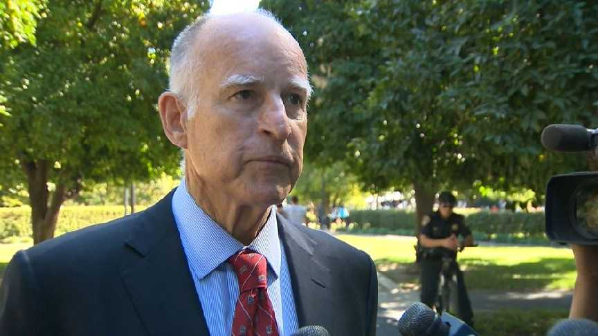 Gov. Jerry Brown speaks with reporters. (Oct 5, 2013)