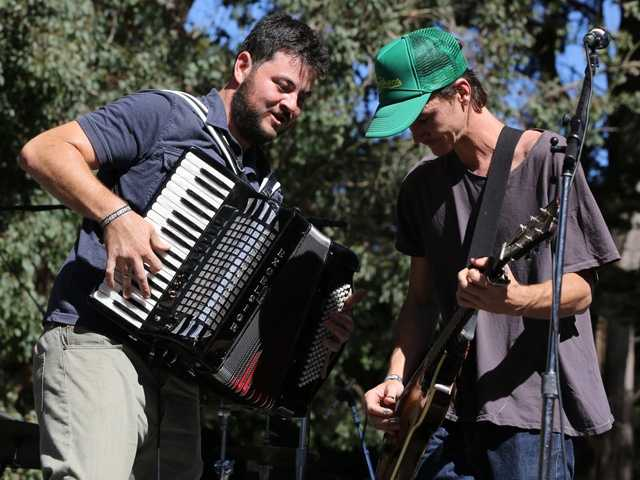 James Felice and Ian Felice of the Felice Brothershave a good time on stage atHardly Strictly Bluegrass in San Francisco's Golden Gate Park on Friday, Oct. 4.
