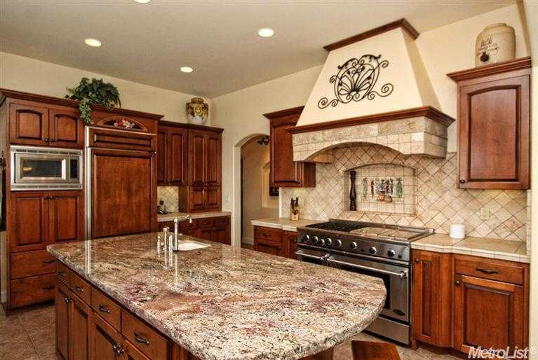 The home has a gourmet kitchen complete with professional range.