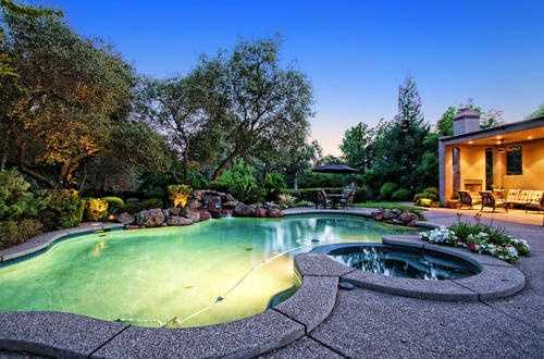 This home has a sparkling pool and spa.