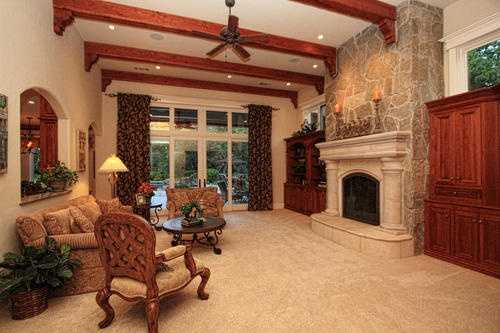 This home has designer ceiling treatments, as seen in this living area.