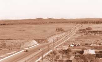 Before it was a busy thoroughfare, Douglas Boulevard was known as Rocky Ridge. Many of the bluffs alongside the road were leveled by dynamite. This photo was taken about 40 years ago.