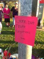 """""""Gone, but never forgotten,"""" reads one sign in Lodi."""