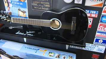 It's a half-sized guitar mounted to become a door chime.