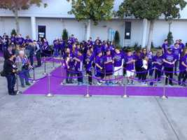 Fans line up along the VIP purple carpet in front of Sleep Train Arena.