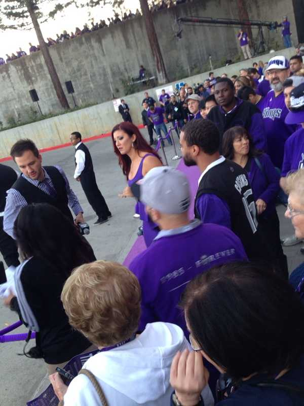 Kings fans gather on the purple carpet at Sleep Train Arena, waiting for VIP members to arrive.