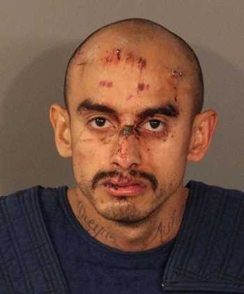 Samuel Duran, 32, was arrested on accusations of injuring five Roseville police officers and a federal immigration agent. He faces seven counts of assault with a semi-automatic weapon on a peace officer, burglary, false imprisonment and being a felon in the possession of a firearm.