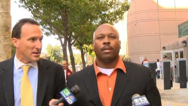 Cortez Quinn, a Twin Rivers Unified School District trustee and former staff member for state Assemblyman Roger Dickinson, is at right. KCRA 3 reporter Mike TeSelle walks alongside him (Nov. 6, 2013).