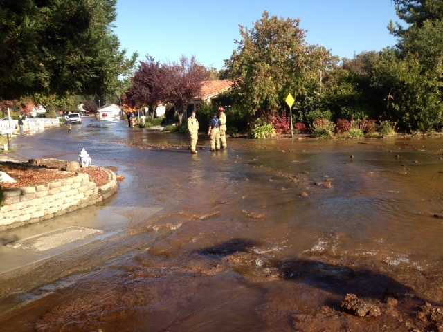 A 14-inch water main broke in a Citrus Heights neighborhood Sunday flooding streets and causing thousands of dollars in damage to four homes.