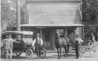Elk Grove has had the services of eight post offices since 1850. In this photo, the range of technology is on full display as U.S. carriers stand next to a horse and carriage and anew automobile.