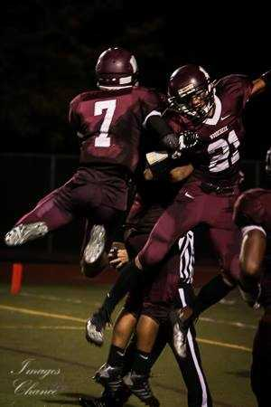 #25 - Woodcreek Wolves celebrate a touchdown in the end zone