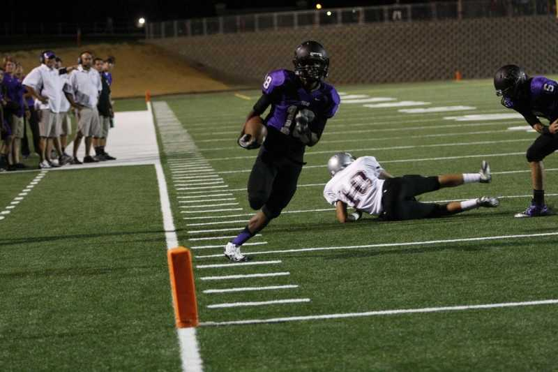 #27 - Tokay's Allen Ward dashes down the sideline toward the end zone after avoiding a defender.