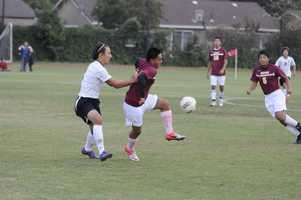 #30 - Edison soccer players show some fancy footwork on the field.