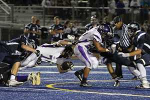 #31 - The Vista del Lago defense works to take down Grant Dragmire of Bradshaw Christian.