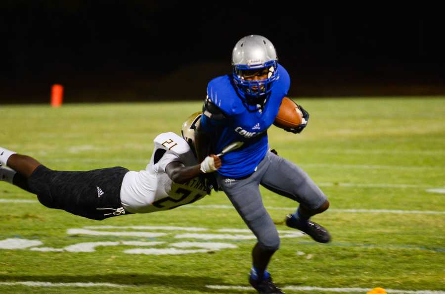 # 35 - A defender is caught in mid-air trying to stop a Capital Christian football player.