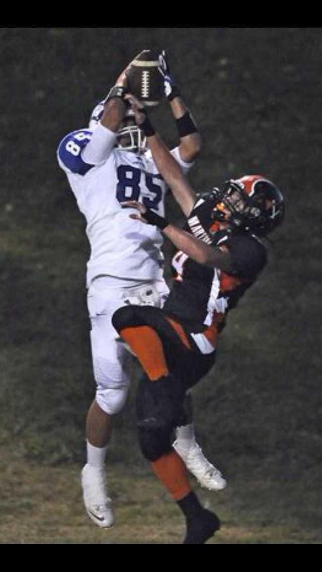 #36 - Jordan Samson, of Wheatland High School, goes up to grab the football against a Marysville defender.