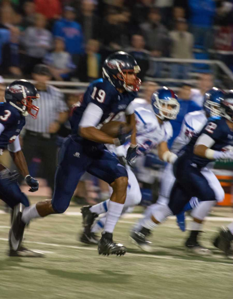 #12 - Pleasant Grove's Wyatt Demps works to beat out Folsom's defense.