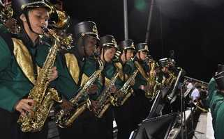 #7 - A row of saxophone players in the Monterey Trail High School band keep the tunes coming at the school's football game.
