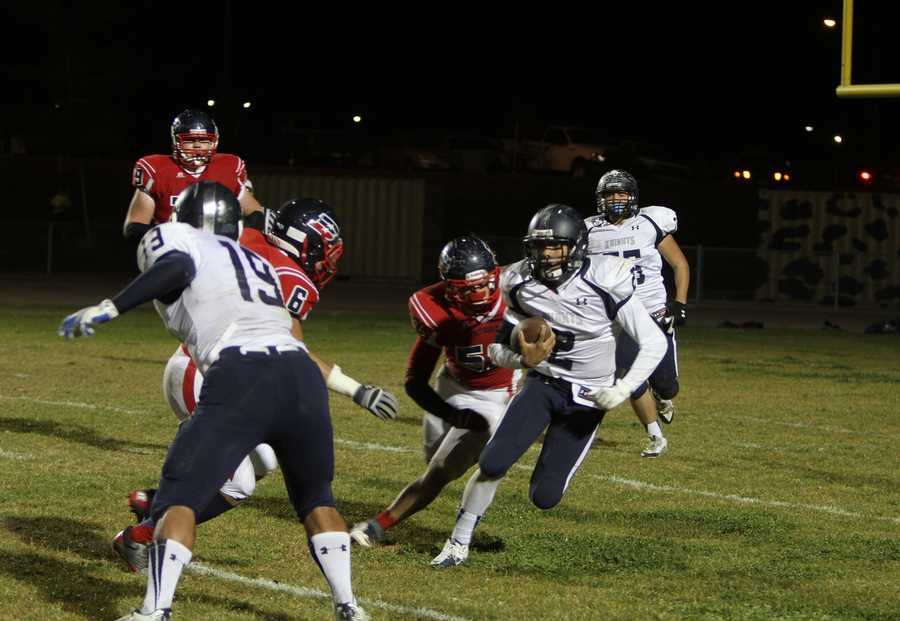 #5 - Quarterback PJ Wilson of Downey High School scrambles for some yards against the Beyer Patriots.