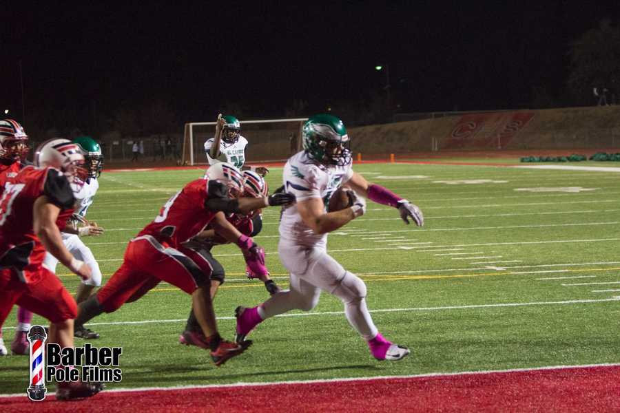 #29 - El Camino's Quenton Hagen goes in for a touchdown.