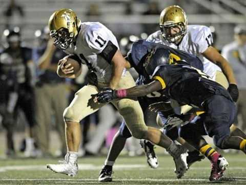 #16 - Yuba City's Kael Williams powers through a couple of defenders.