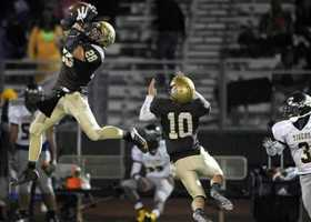 #44 - Austin Thompson, of Yuba City, snatches the ball as his teammate, Scott Azevedo, backs him up.