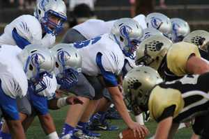 #17 - This tight shot shows the line before the ball is snapped in a game between Capital Christian and Golden Sierra.