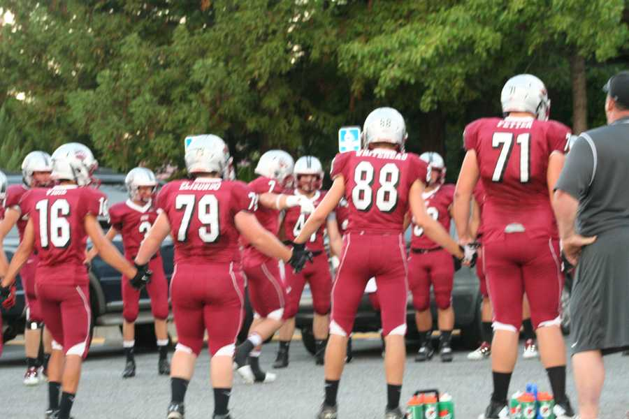 #23 - Bear River's varsity football team joins hands before taking the field.