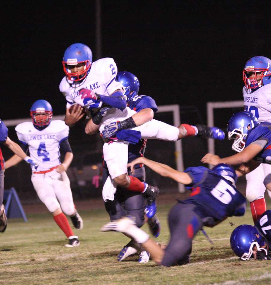 #22 - Lower Lake's Isazah King is stopped mid-air by the Duham defense.