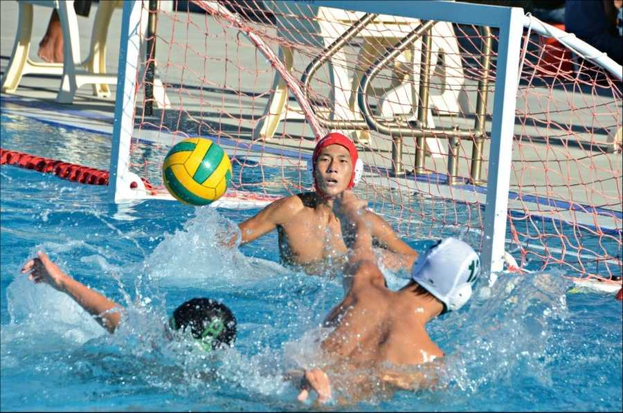 #49 - The Dixon Rams water polo team shoots for the back of the net.
