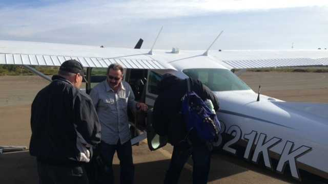 Friends of Stephen Pease board a plane at Little River Airport (Nov. 14, 2013).