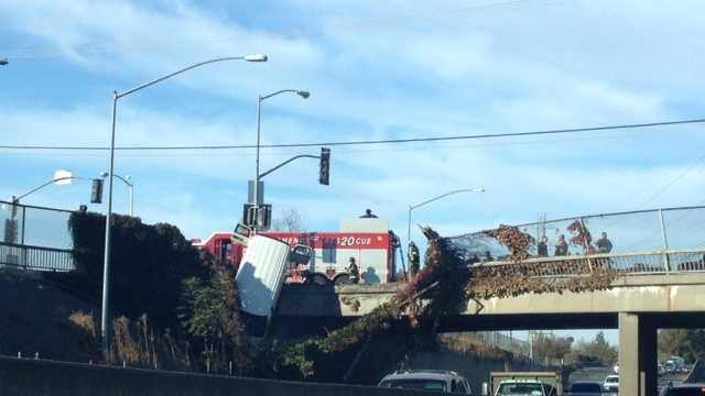 I80 crash car hanging over overpass