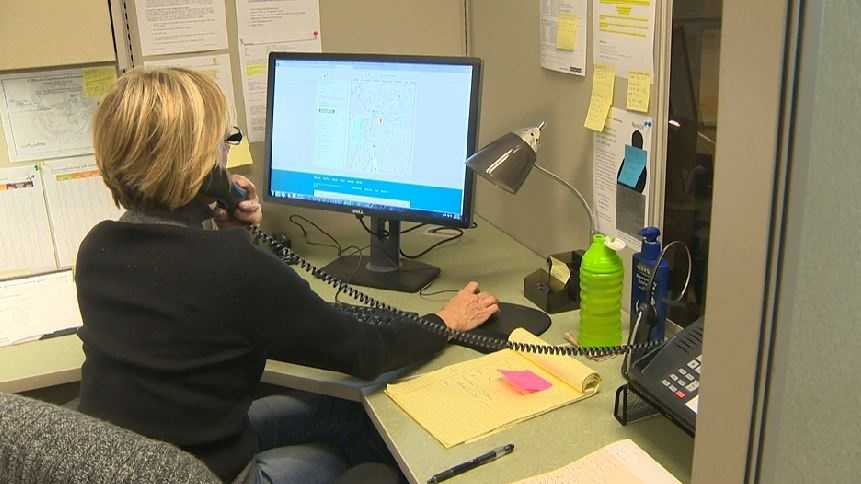 A representative of Western Health Advantage speaks on the phone at the insurance company's call center in Sacramento.