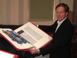 In the tradition of great medieval Bibles, The Saint John's Bible is monumental -- 2 feet tall, 3 feet wide and more than 1,100 pages. This is Jim Trigg, of St.John's University, which sponsored the project.